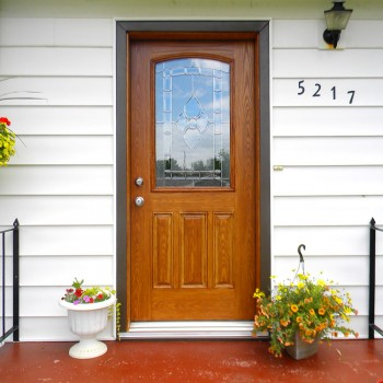 Solid wood entrance door with inlaid glass pane