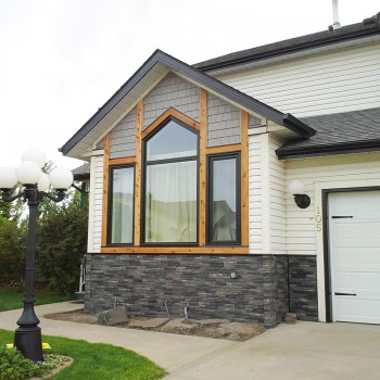 Custom vinyl windows with natural wood trim